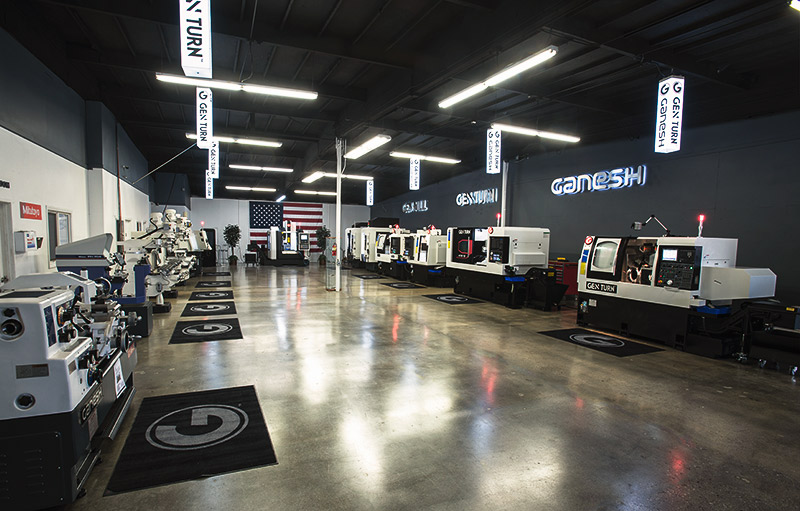 Wide angle shot of the interior showroom for Expand Machinery showing many CNC and turning machines