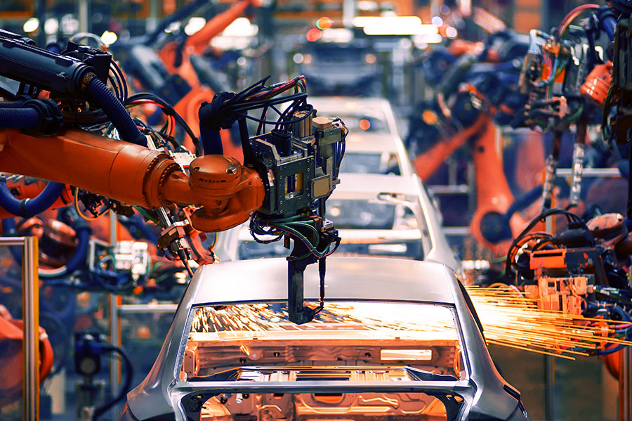 automated robots in an assembly line welding